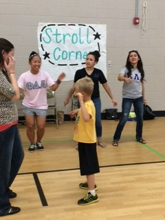 Kids enjoy learning steps in the stroll corner!