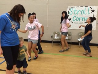 MGC members teach dance steps to students in the stroll corner!
