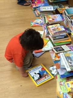 A student chooses his book from the book walk!