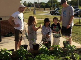 ​Week 8. The CASP staff and the Garden Your Own Growth team watch on as students water the garden and take responsibility for their food.